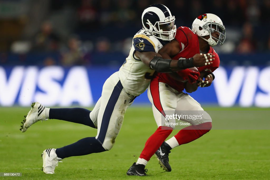 Kerwynn Williams (R) of Arizona Cardinals is tackled by Alec Ogletree of Los Angeles Rams during the NFL game between Arizona Cardinals and Los Angeles Rams at Twickenham Stadium on October 22, 2017 in London, England.