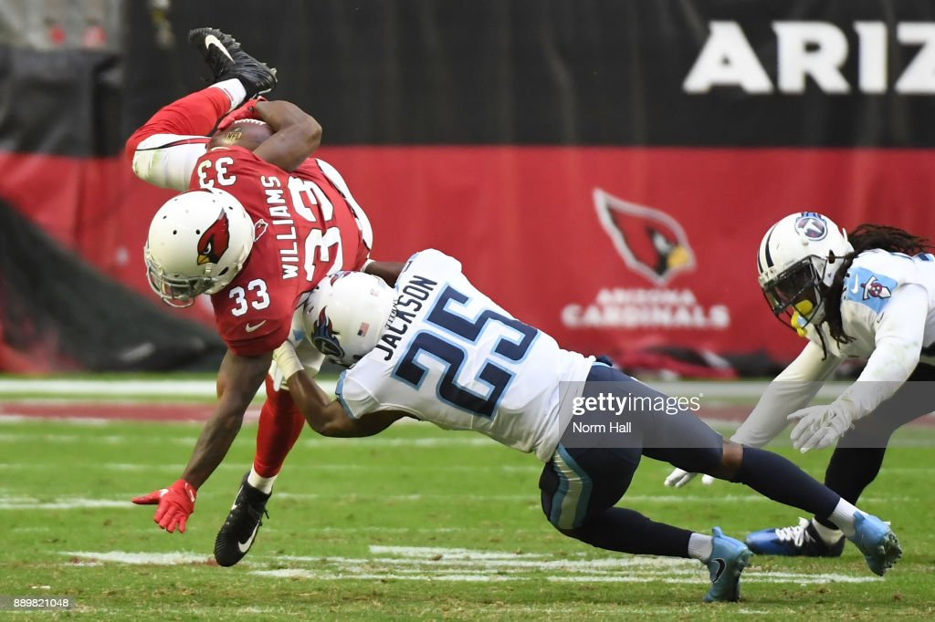 Kerwynn Williams #33 of the Arizona Cardinals is tackled by Adoree' Jackson #25 of the Tennessee Titans in the second half at University of Phoenix Stadium on December 10, 2017 in Glendale, Arizona.
