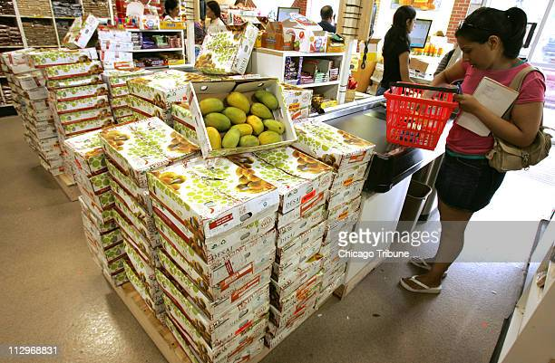 Kesar mangoes from India sit on display for sale at Patel Brothers Market in Chicago Illinois May 31 2007 They have to be irradiated before entering...
