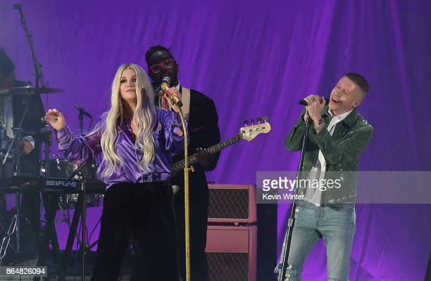 Kesha and Macklemore perform onstage at CBS RADIO's We Can Survive 2017 at The Hollywood Bowl on October 21 2017 in Los Angeles California