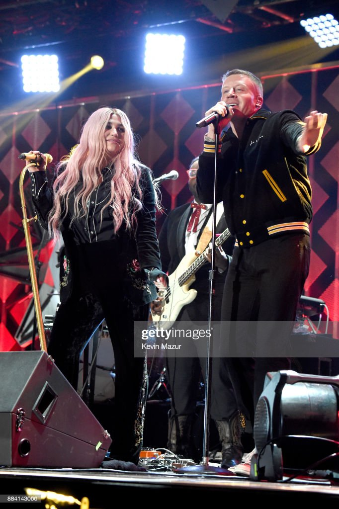 Kesha (L) and Macklemore perform onstage during 102.7 KIIS FM's Jingle Ball 2017 presented by Capital One at The Forum on December 1, 2017 in Inglewood, California.