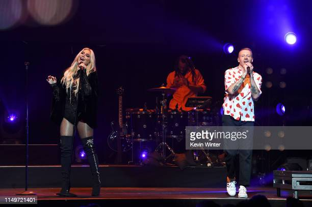 Kesha and Macklemore perform onstage during MusiCares® Concert For Recovery Presented by Amazon Music Honoring Macklemore at The Novo at LA Live on...