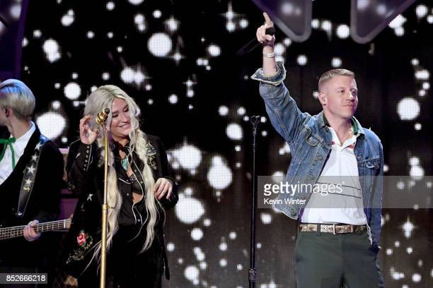 Kesha and Macklemore perform onstage during the 2017 iHeartRadio Music Festival at TMobile Arena on September 23 2017 in Las Vegas Nevada