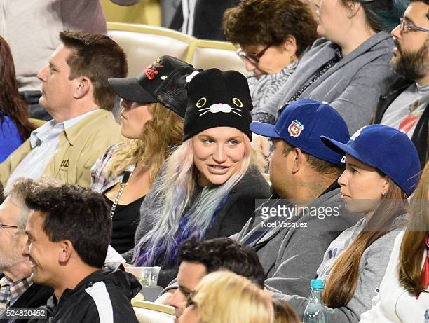 Kesha attends a baseball game between the Miami Marlins and the Los Angeles Dodgers at Dodger Stadium on April 26 2016 in Los Angeles California