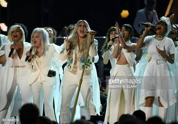 TOPSHOT Kesha performs with Bebe Rexha Cindy Lauper Camila Cabello and Andra Day during the 60th Annual Grammy Awards show on January 28 in New York...