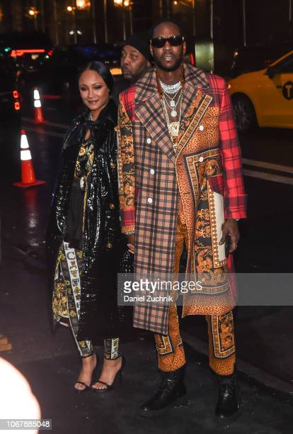 Kesha Ward and 2 Chainz are seen wearing Versace outfits outside the Versace PreFall 2019 Collection on December 2 2018 in New York City