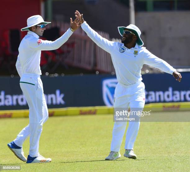 Keshaf Maharaj and Temba Bavuma of the Proteas celebrate the wicket of Mominul Haque of Bangladesh during day 3 of the 2nd Sunfoil Test match between...