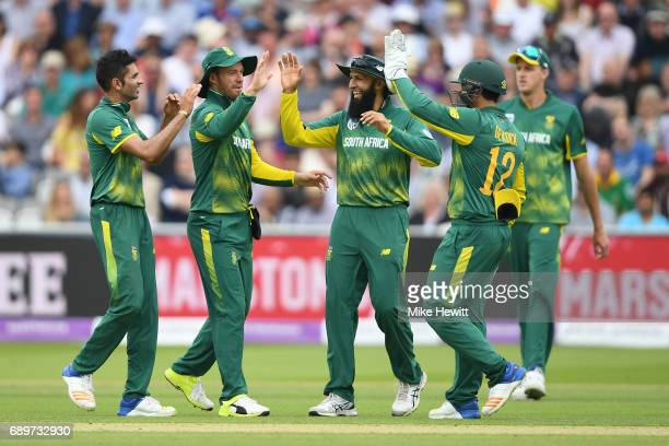 Keshav Maharaj AB de Villiers Hashim Amla and Quinton de Kock of South Africa celebrate the wicket of Adil Rashid of England during the 3rd Royal...