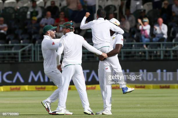 Keshav Maharaj and Kagiso Rabada celebrate during day 4 of the 3rd Sunfoil Test match between South Africa and Australia at PPC Newlands on March 25...