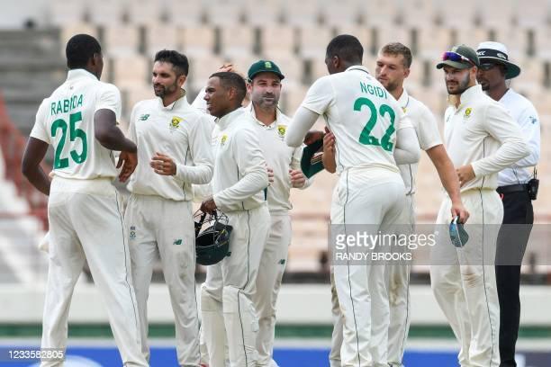 Keshav Maharaj , Keegan Petersen , Dean Elgar , Wiaan Mulder and Aiden Markram of South Africa celebrate winning on day 4 of the 2nd Test between...