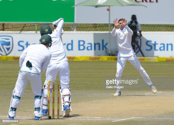 Keshav Maharaj of South Africa bowls and catches as he takes a wicket during day 5 of the 1st Sunfoil Test match between South Africa and Bangladesh...