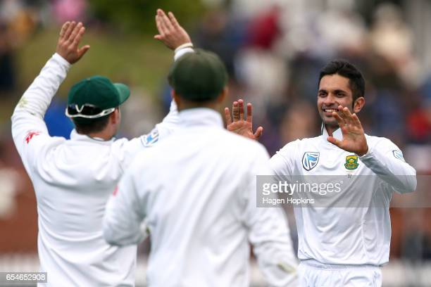 Keshav Maharaj of South Africa celebrates after taking the wicket of Jeetan Patel of New Zealand to secure his 5 wicket bag during day three of the...