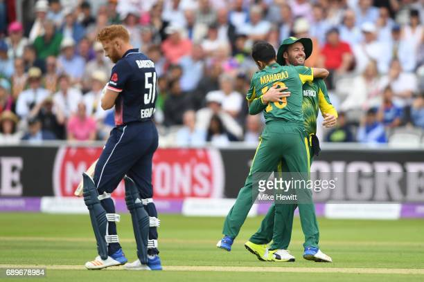 Keshav Maharaj of South Africa celebrates with team mate AB de Villiers after dismissing Jonny Bairstow of England during the 3rd Royal London ODI...