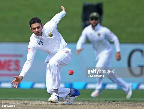 Keshav Maharaj of South Africa fields as he bowls during day three of the Test match between New Zealand and South Africa at Seddon Park on March 27...
