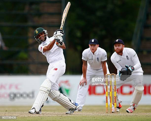 Keshav Maharaj of South Africa hits out as Jonny Bairstow of England keeps wicket during day three of the tour match between South Africa A and...