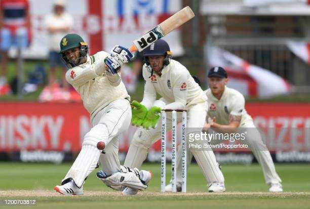 Keshav Maharaj of South Africa hits out watched by Jos Buttler and Ben Stokes during the Third Test between England and South Africa on January 20,...