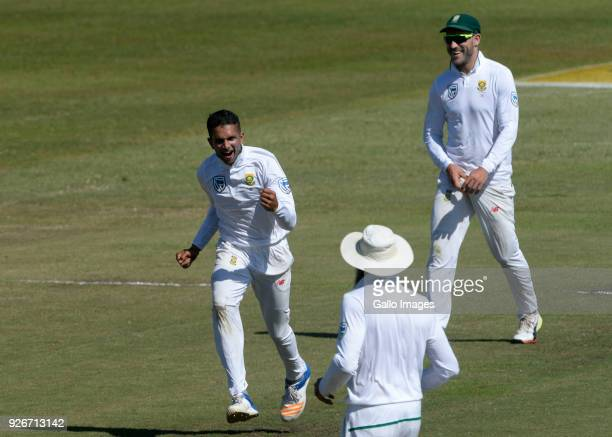 Keshav Maharaj of the Proteas celebrates the wicket of Tim Paine of Australia during day 3 of the 1st Sunfoil Test match between South Africa and...