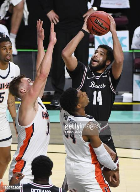 Keshawn Justice of the Santa Clara Broncos is called for an offensive charge as he drives against Victor Ohia Obioha and Jan Zidek of the Pepperdine...