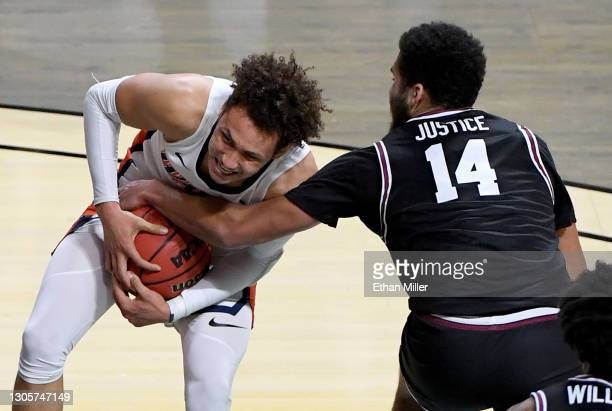 Keshawn Justice of the Santa Clara Broncos ties up Colbey Ross of the Pepperdine Waves for a jump ball during the West Coast Conference basketball...