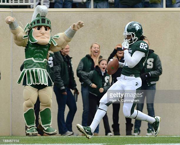 Keshawn Martin of the Michigan State Spartans scores a touchdown on a pass from Kirk Cousins during the first quarter of the game against the Indiana...