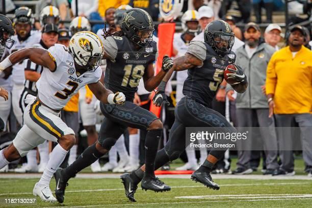 Ke'Shawn Vaughn of the Vanderbilt Commodores scores a 61 yard touchdown reception against the Missouri Tigers during the first half at Vanderbilt...