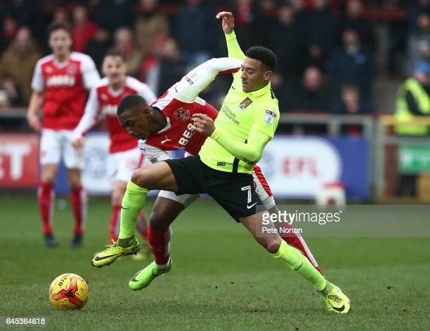 Keshi Anderson of Northampton Town contests the ball with Amari'i Bell of Fleetwood Town during the Sky Bet League One match between Fleetwood Town...