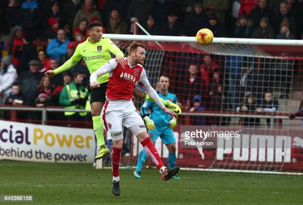 Keshi Anderson of Northampton Town contests the ball with Cian Bolger of Fleetwood Town during the Sky Bet League One match between Fleetwood Town...