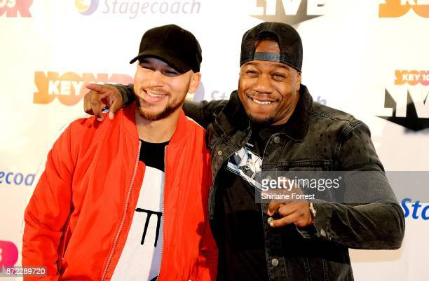 Kesi Dryden and Leon Rolle aka DJ Locksmith of Rudimental pose at Key 103 Live at Manchester Arena on November 9 2017 in Manchester England