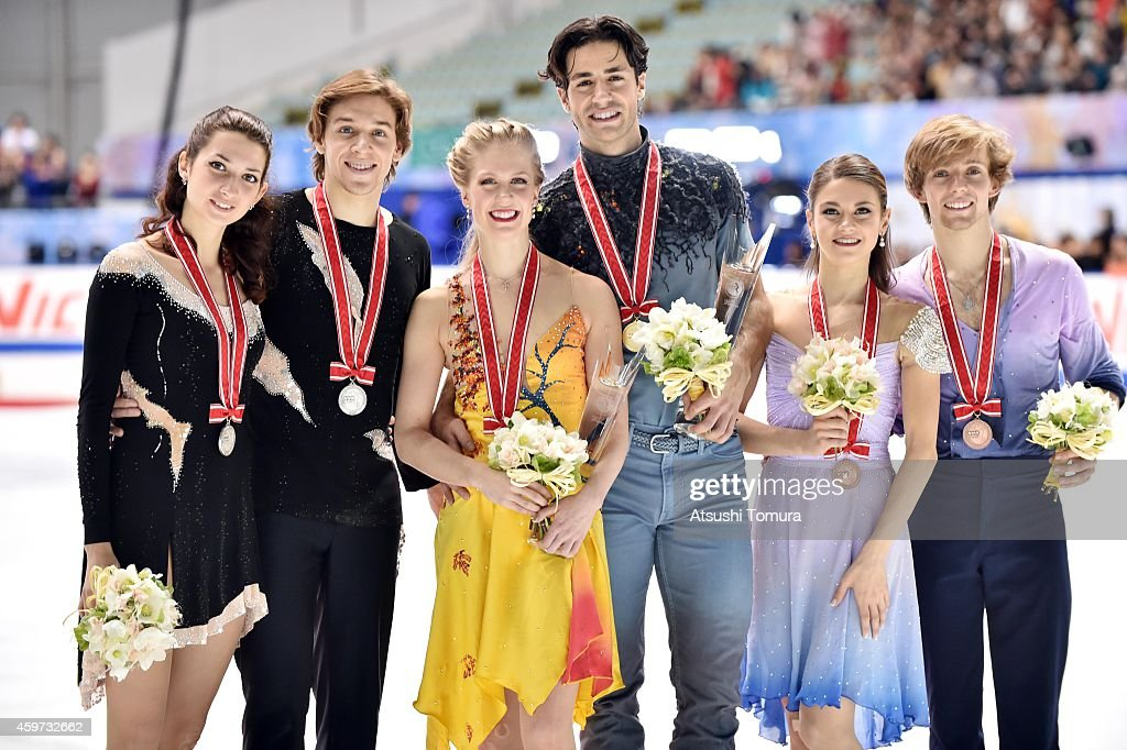 Kesnia Monko and Kirill Khaliavin of Russia (Silver), Kaitlyn Weaver and Andrew Poje of Canada (Gold) and Kaitlin Hawayek and Jean-Luc Baker of the USA (Bronze) pose with medal in the victory ceremony during day three of ISU Grand Prix of Figure Skating 2014/2015 NHK Trophy at the Namihaya Dome on November 30, 2014 in Osaka, Japan.