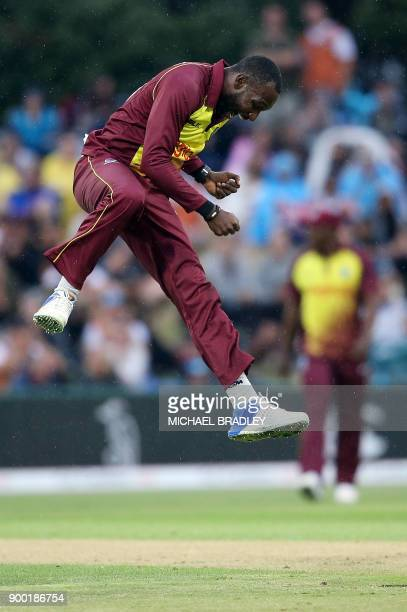 Kesrick Williams of the West Indies celebrates after taking the wicket of New Zealand's Colin Munro during the second Twenty20 international cricket...