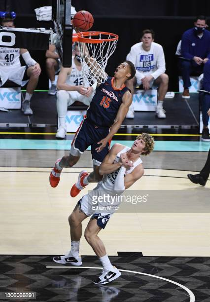 Kessler Edwards of the Pepperdine Waves scores against Caleb Lohner of the Brigham Young Cougars during the West Coast Conference basketball...
