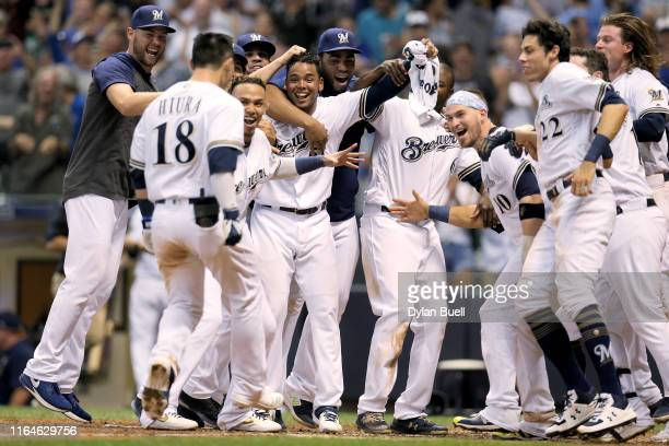 Keston Hiura of the Milwaukee Brewers celebrates with teammates after hitting a home run to beat the Chicago Cubs 53 at Miller Park on July 27 2019...