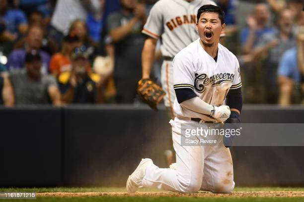 Keston Hiura of the Milwaukee Brewers reacts after scoring on a sacrifice fly during the eighth inning against the San Francisco Giants at Miller...