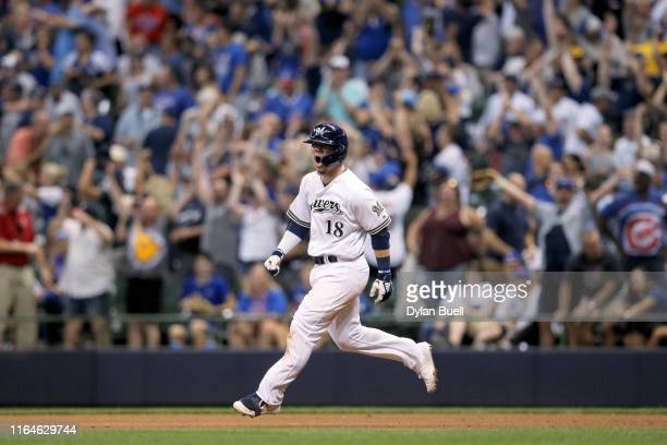 Keston Hiura of the Milwaukee Brewers rounds the bases after hitting a home run in the tenth inning to beat the Chicago Cubs 5-3 at Miller Park on...