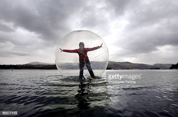 Keswick Mountain Festival volunteer Tara Vallente walks on water inside an inflatable sphere on Derwent Water in the Lake District on March 24 2009...