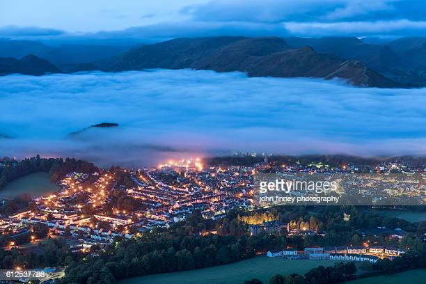keswick street lights and mist. lake district national park. uk. europe. - whitehaven cumbria stock pictures, royalty-free photos & images