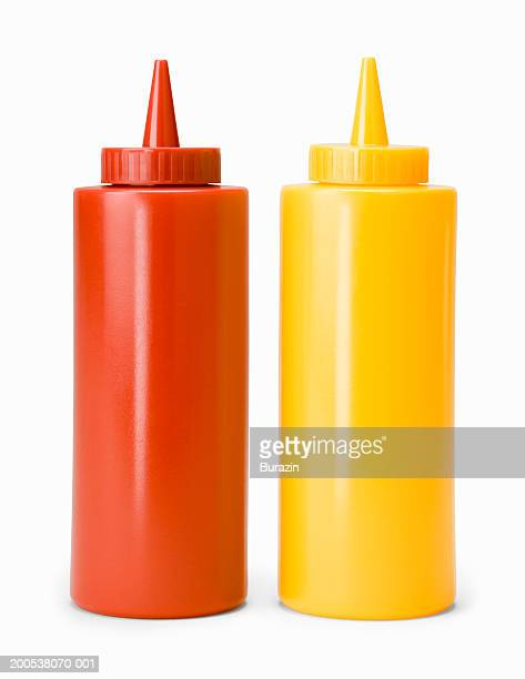 ketchup and mustard bottles, against white background, close-up - tomato sauce stock pictures, royalty-free photos & images