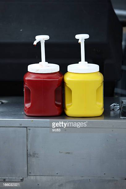 Ketchup and mustard dispensers at street hot dog stand