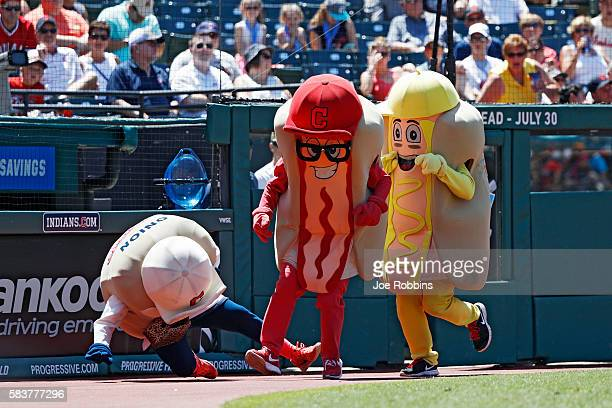 Ketchup trips up Onion as mascots race between innings of the game between the Cleveland Indians and Washington Nationals at Progressive Field on...