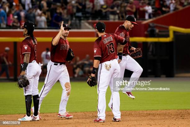 Ketel Marte AJ Pollock Nick Ahmed and David Peralta of the Arizona Diamondbacks celebrate after defeating the Astros 31 on May 6 2018 at Chase Field...