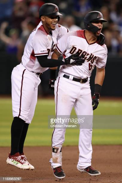 Ketel Marte and David Peralta of Arizona Diamondbacks celebrate after Peralta had a walk-off RBI single against the Los Angeles Dodgers during the...