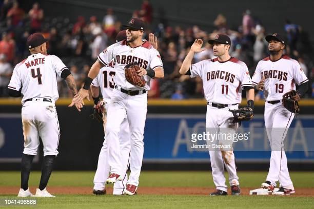 Ketel Marte David Peralta AJ Pollock and Socrates Brito of the Arizona Diamondbacks celebrate after closing out the MLB game against the Los Angeles...