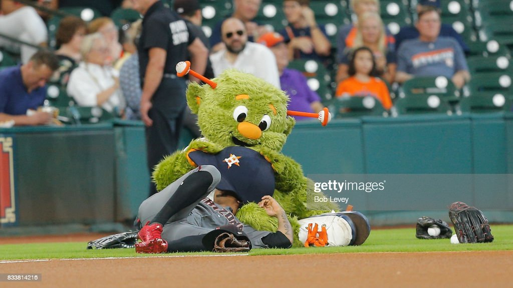 Ketel Marte #4 of the Arizona Diamondbacks and Houston Astros mascot Orbit fool around before the start of the game at Minute Maid Park on August 17, 2017 in Houston, Texas.