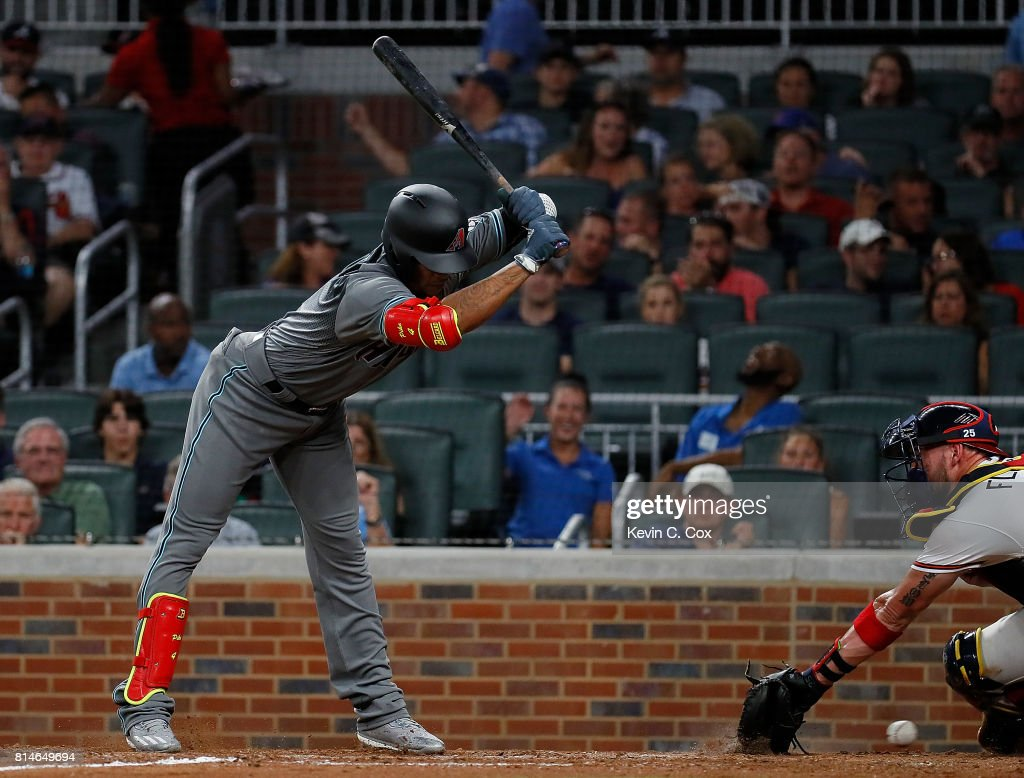 Ketel Marte #4 of the Arizona Diamondbacks avoids a wild pitch by Jose Ramirez #52 that gets by Tyler Flowers #25 of the Atlanta Braves and allows Chris Owings #16 to score in the eighth inning at SunTrust Park on July 14, 2017 in Atlanta, Georgia.