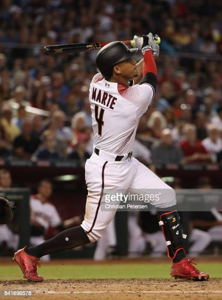 Ketel Marte of the Arizona Diamondbacks bats against the Los Angeles Dodgers during the MLB game at Chase Field on August 30 2017 in Phoenix Arizona
