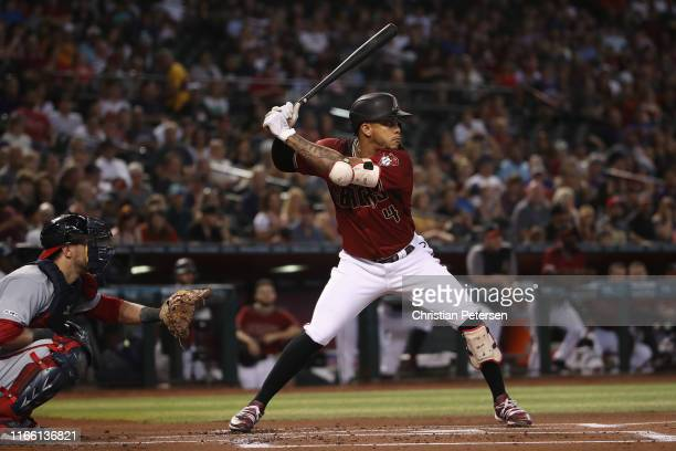 Ketel Marte of the Arizona Diamondbacks bats against the Washington Nationals during the MLB game at Chase Field on August 04 2019 in Phoenix Arizona...