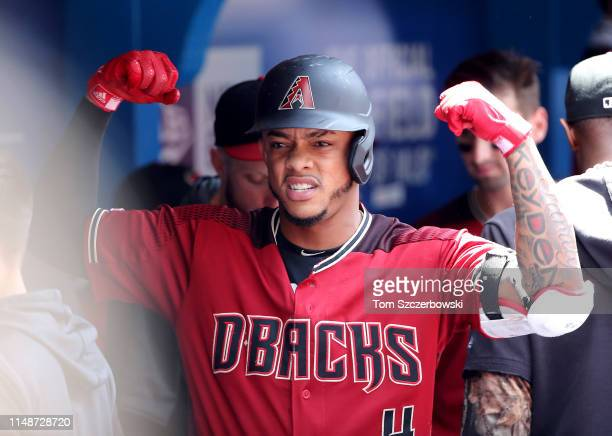 Ketel Marte of the Arizona Diamondbacks celebrates after hitting a solo home run in the third inning during MLB game action against the Toronto Blue...
