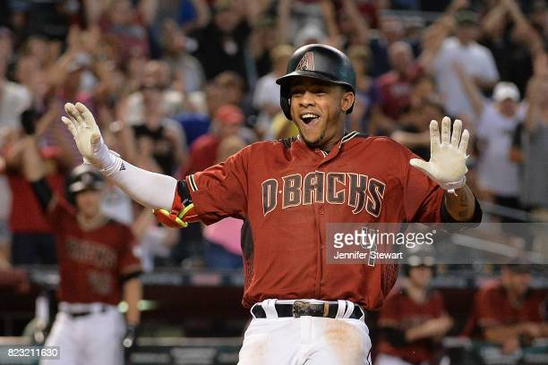 Ketel Marte of the Arizona Diamondbacks celebrates after hitting a two run inside-the-park home run against the Atlanta Braves during the third...