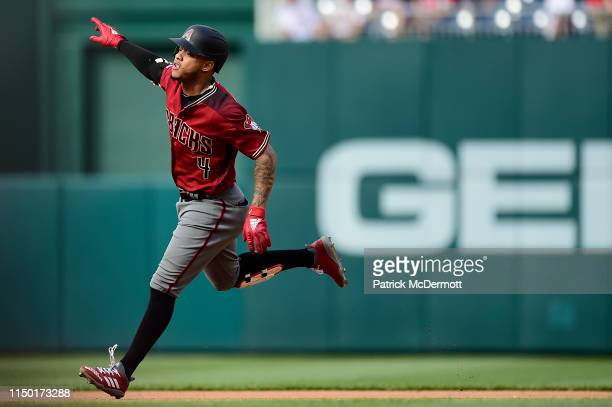 Ketel Marte of the Arizona Diamondbacks celebrates as he runs the bases after hitting a solo home run in the fourth inning against the Washington...