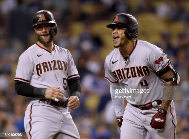 Ketel Marte of the Arizona Diamondbacks celebrates his three run homerun with Christian Walker, to trail 6-4 to the Los Angeles Dodgers, during the...